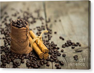 Coffee Beans And Cinnamon Stick Canvas Print by Aged Pixel