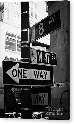 Manhatan Canvas Print - collection of street signs 8th Avenue and west 47th Street one way new york city by Joe Fox