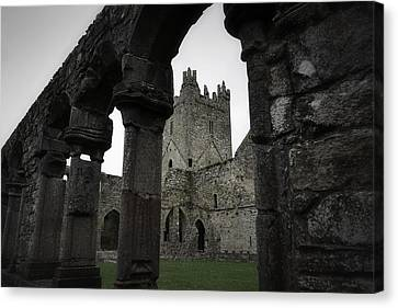 Colonnade And Tower Of Jerpoint Abbey Canvas Print by Nadalyn Larsen