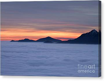 Colored Sunset Canvas Print by Maurizio Bacciarini