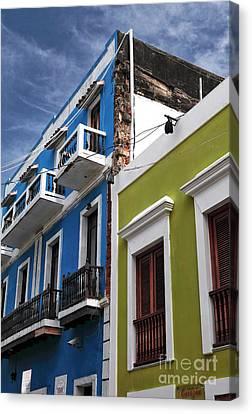 Colores Del Edificio Canvas Print by John Rizzuto