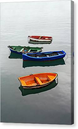 colorful boats on Santurtzi Canvas Print by Mikel Martinez de Osaba