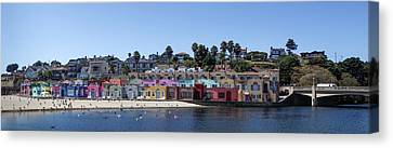 Flock Of Birds Canvas Print - Colorful Buildings And Beach by Panoramic Images
