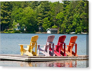 Canvas Print featuring the photograph Colorful Chairs by Les Palenik