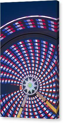 Independance Canvas Print - Colorful Spinning Ferris Wheel Close-up by John Franco