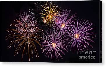 Colorful Fireworks Canvas Print by Anek Suwannaphoom