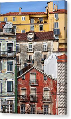 Colorful Houses In The City Of Lisbon Canvas Print by Artur Bogacki