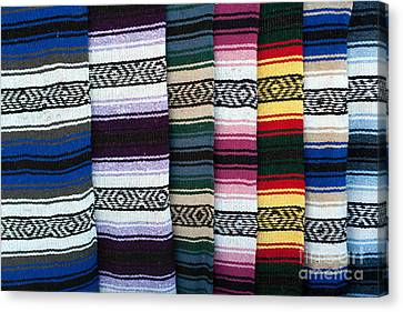 Canvas Print featuring the photograph Colorful Indian Rug Display by Gunter Nezhoda
