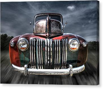 Colorful Rusty Ford Head On Canvas Print by Gill Billington