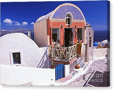 Colorful Shops In Oia Canvas Print by Aiolos Greek Collections