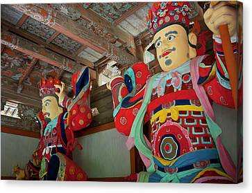 Colorful Statues At The Buddhist Canvas Print by Michael Runkel