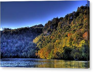 Canvas Print featuring the photograph Colorful Trees Over A Lake by Jonny D