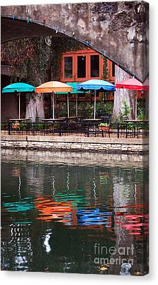 Colorful Umbrellas Reflected In Riverwalk Under Footbridge San Antonio Texas Vertical Format Canvas Print by Shawn O'Brien