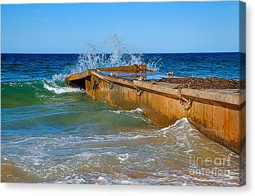 Colorful Waves Around Old Pier Canvas Print by Kaye Menner