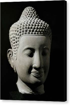 Colossal Buddha Head. 13th-14th C Canvas Print by Everett