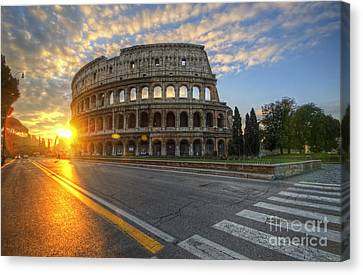 Colosseo Golden Sunrise Canvas Print by Yhun Suarez
