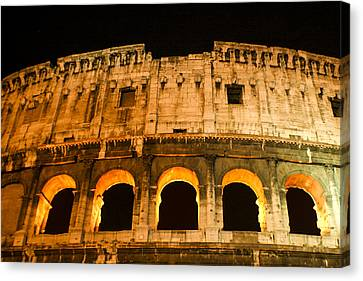 Canvas Print featuring the photograph Colosseum At Night by Rob Tullis