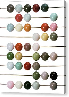 Colourful Beads On Metal Rods Canvas Print by Herbert Matter