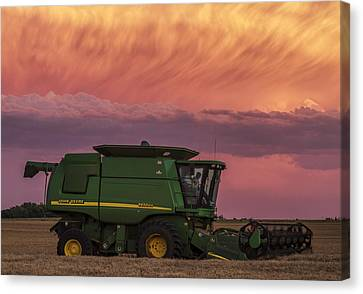 Canvas Print featuring the photograph Combine At Sunset by Rob Graham