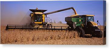 Combine Harvesting Soybeans In A Field Canvas Print by Panoramic Images
