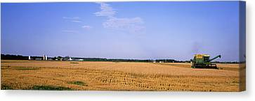 Combine In A Field, Marion County Canvas Print by Panoramic Images
