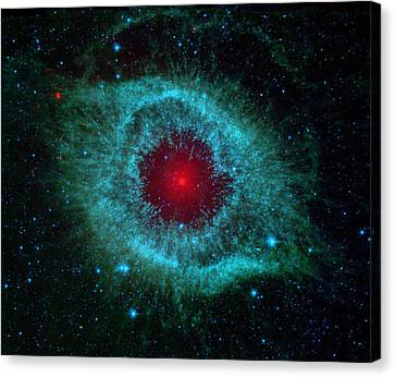 Comets Kick Up Dust In Helix Nebula Canvas Print