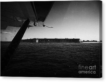 Coming In To Land On The Water In A Seaplane Next To Fort Jefferson Garden Key Dry Tortugas Florida  Canvas Print by Joe Fox