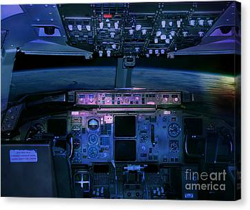 Commercial Airplane Cockpit By Night Canvas Print by Gunter Nezhoda
