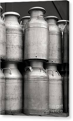 Commercial Milk Cans Black And White Canvas Print by Iris Richardson