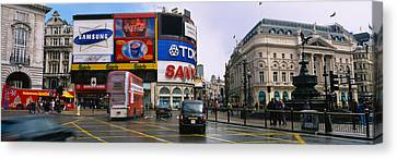 Commercial Signs On Buildings Canvas Print by Panoramic Images