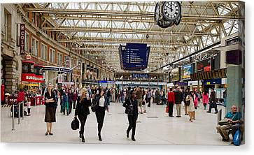 Commuters At A Railroad Station Canvas Print by Panoramic Images