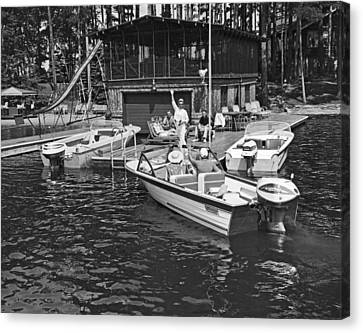 Company Arrives At The Cabin By Boat Canvas Print by Underwood Archives