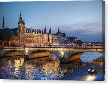 Canvas Print featuring the photograph Conciergerie And Pont Napoleon At Twilight by Jennifer Ancker