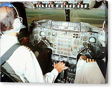 Concorde Pilots In Cockpit Canvas Print by Us National Archives