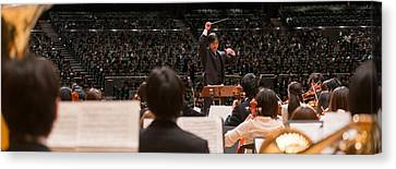 Conductor Leading Orchestra Canvas Print by Panoramic Images