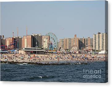 Coney Island Seen From The Pier Canvas Print by John Telfer
