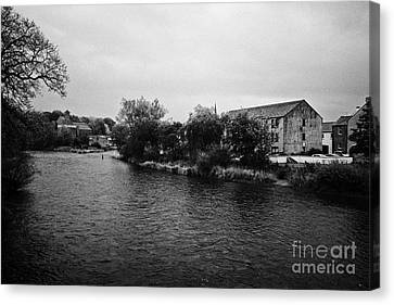 Confluence Of The Rivers Cocker And Derwent On A Rainy Overcast Day Cockermouth Cumbria England Canvas Print by Joe Fox