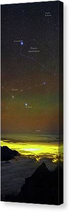 Constellations Over Clouds Canvas Print by Babak Tafreshi