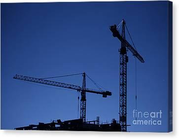 Construction Cranes At Dusk Canvas Print by Antony McAulay