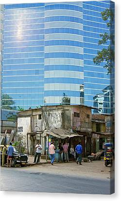 Contrasting Buildings In Mumbai Canvas Print by Mark Williamson