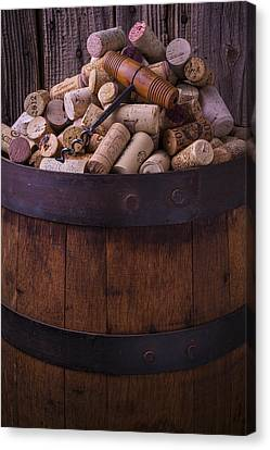 Corkscrew And Corks On Wine Barrel Canvas Print by Garry Gay