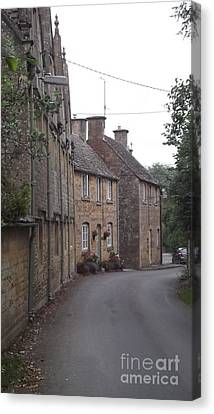 Cotswold Cottages Canvas Print by John Williams