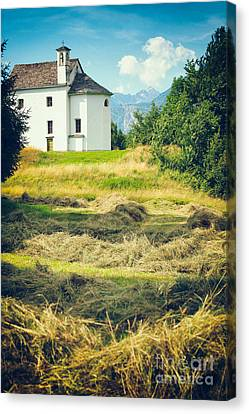Canvas Print featuring the photograph Country Church With Hay by Silvia Ganora