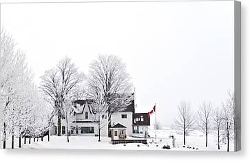 Country Side House In Canada Winter Time Canvas Print by Marek Poplawski