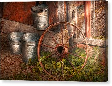 Country - Some Dented Pails And An Old Wheel  Canvas Print by Mike Savad