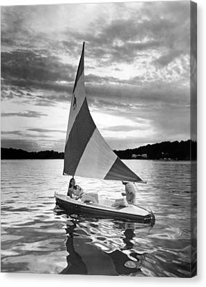 Couple Enjoys A Sunset Sail Canvas Print by Underwood Archives