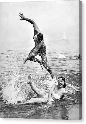 Couple Frolics In The Surf Canvas Print by Underwood Archives