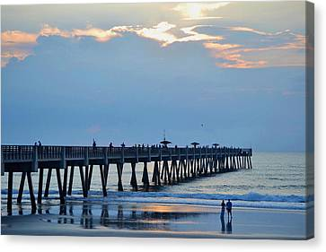 Couple Holding Hands And Watching Sunrise Near The Pier Canvas Print by James Fowler