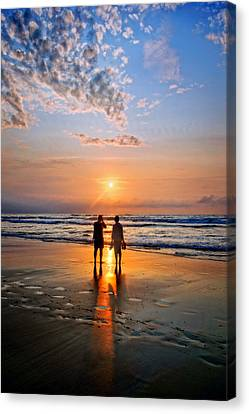 Couple On Beach At Sunset Canvas Print