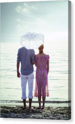 Couple On The Beach Canvas Print by Joana Kruse